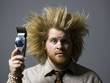 man with crazy hair holding hair clippers
