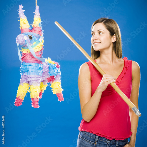 woman hitting a pinata