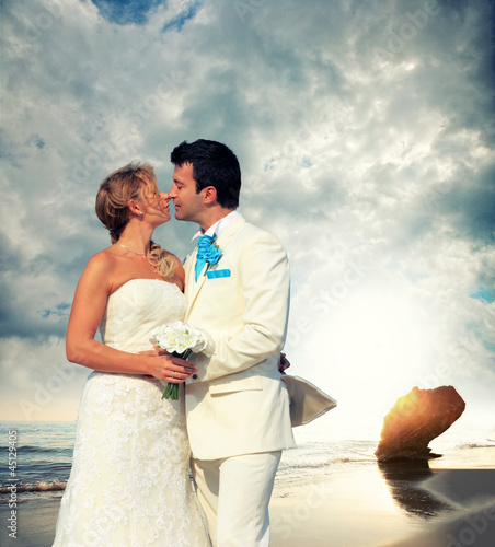 Young couple in tropical beach