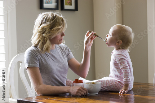 mother and baby girl at the breakfast table