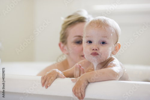 mother and baby taking a bubble bath