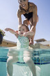 mother and child at a swimming pool