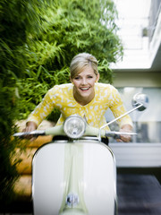 woman on a classic scooter