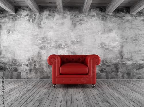 grunge interior with red armchair
