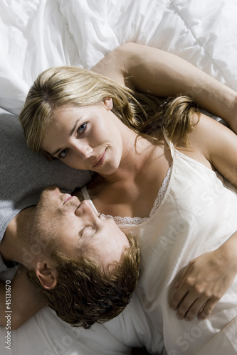 young couple lying on the bed