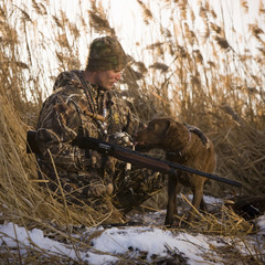 hunter and his dog in a field