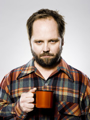 man holding a mug