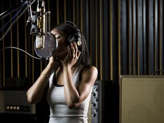 singing in a recording studio