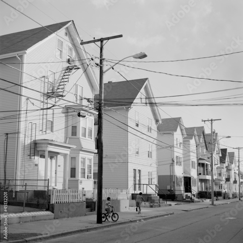 """USA, Rhode Island, Central Falls, Children playing at suburbs"""