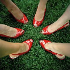 """""""USA, Utah, Salt Lake City, Close-up on six women feet in red peeptoe shoes"""""""