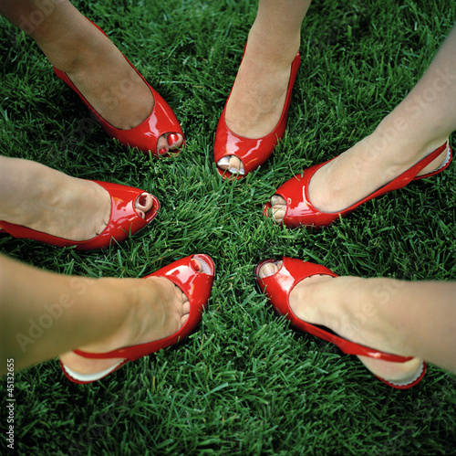 """USA, Utah, Salt Lake City, Close-up on six women feet in red peeptoe shoes"""