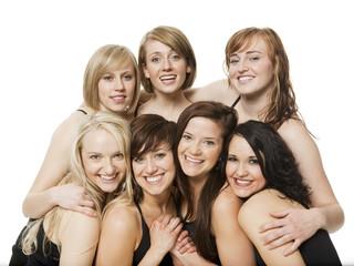 Studio shot of happy young women posing together