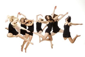 Studio shot of seven young woman dancing