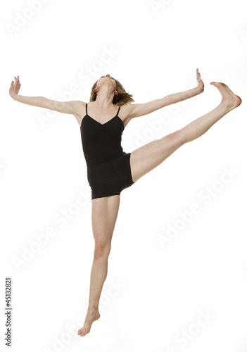 Studio shot of young woman dancing