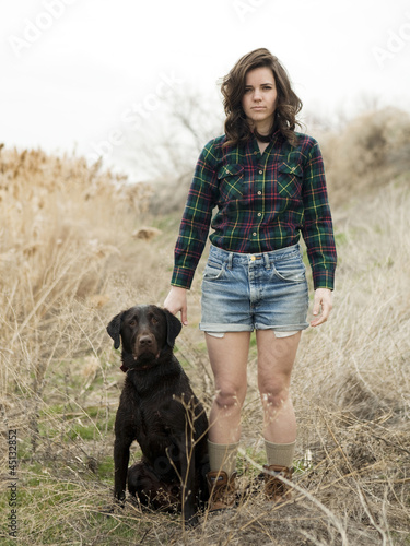 """USA, Utah, Orem, Portrait of young woman posing with dog"""