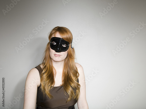 Studio shot of woman wearing mask