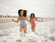 """USA, California, Los Angeles, Two girls (6-11) playing on beach"""