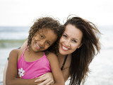 """USA, California, Los Angeles, Portrait of mother and daughter (6-7) on beach"""