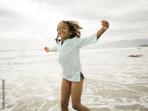 """USA, California, Los Angeles, Girl (6-7) on beach"""