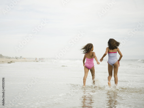 """USA, California, Los Angeles, Two girls (6-11) walking on beach"""