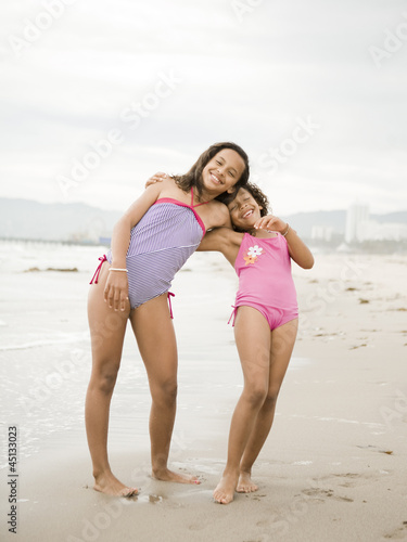 """USA, California, Los Angeles, Portrait of two girls (6-11) on beach"""