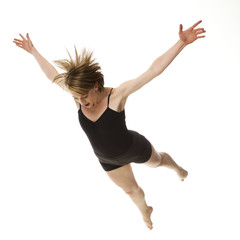Woman falling against white background