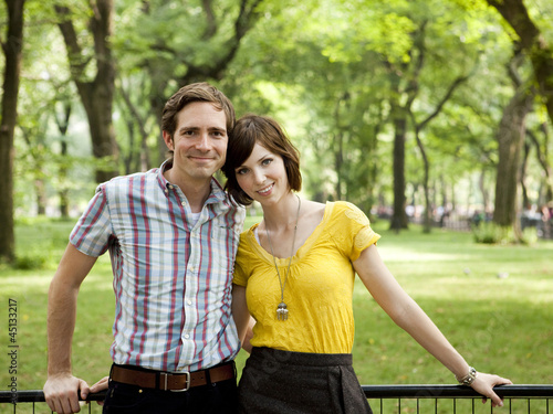 """USA, New York, New York City, Portrait of young couple in park"""