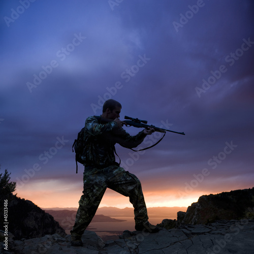 hunter against a sunset