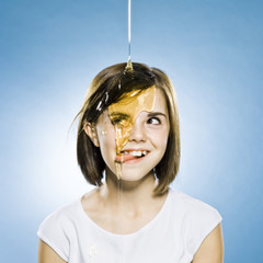 girl with honey pouring on her head