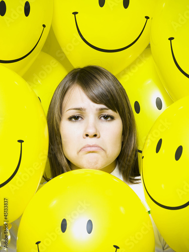 woman with smiley face balloons