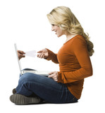 woman buying concert tickets on a laptop
