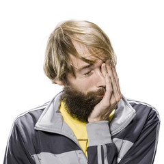 man with a beard wearing a track jacket