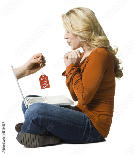 woman shopping on a laptop