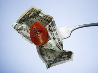 tomato and dollar on a fork