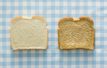 slice of white bread and slice of wheat bread