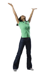 woman in green shirt with arms outstretched