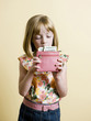 little girl putting money in her pink wallet