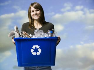 woman holding recycling bin
