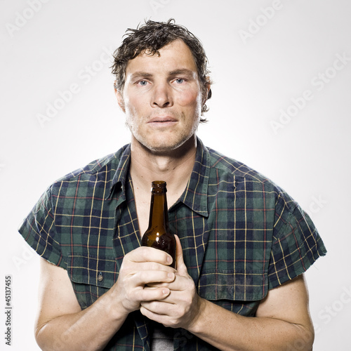 homeless man holding a beer bottle