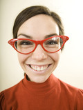 woman smiling wearing horn rimmed glasses