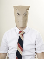 businessman with a brown paper bag over his head