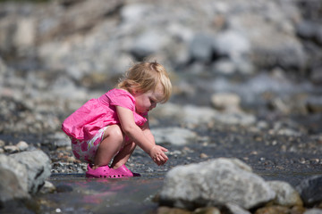 Baby playing in a creek