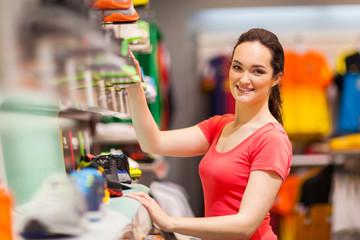 sportswear shop assistant portrait inside store