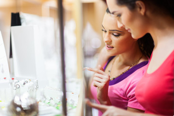 two young woman shopping for jewellery