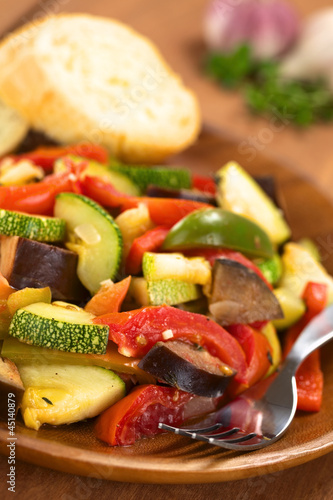 Ratatouille made of eggplant, zucchini, bell pepper and tomato