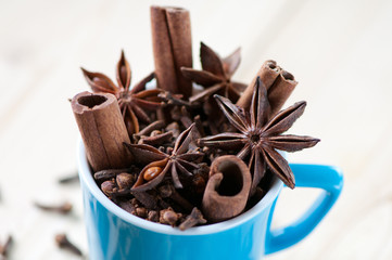 Espresso cup with cinnamon sticks, anise and cloves