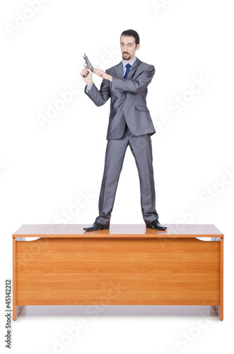 Businessman with gun on white
