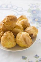 Choux buns on a white plate