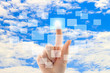 Cloud computing concept with woman hand on blue sky background
