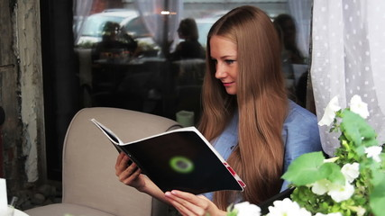 girl with a menu in a cafe